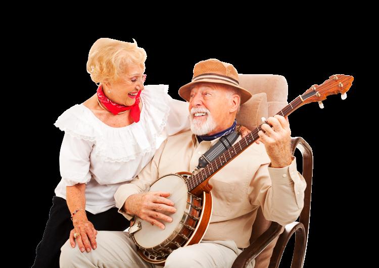 A happy Hispanic elderly couple playing music
